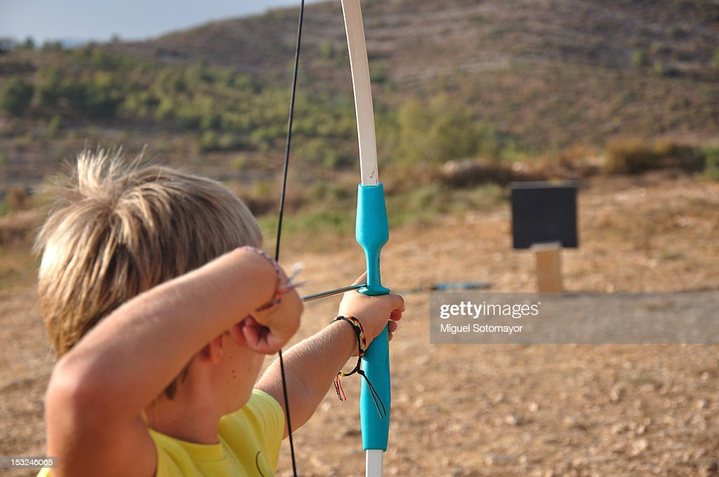 Boy playing with bow : Stock Photo