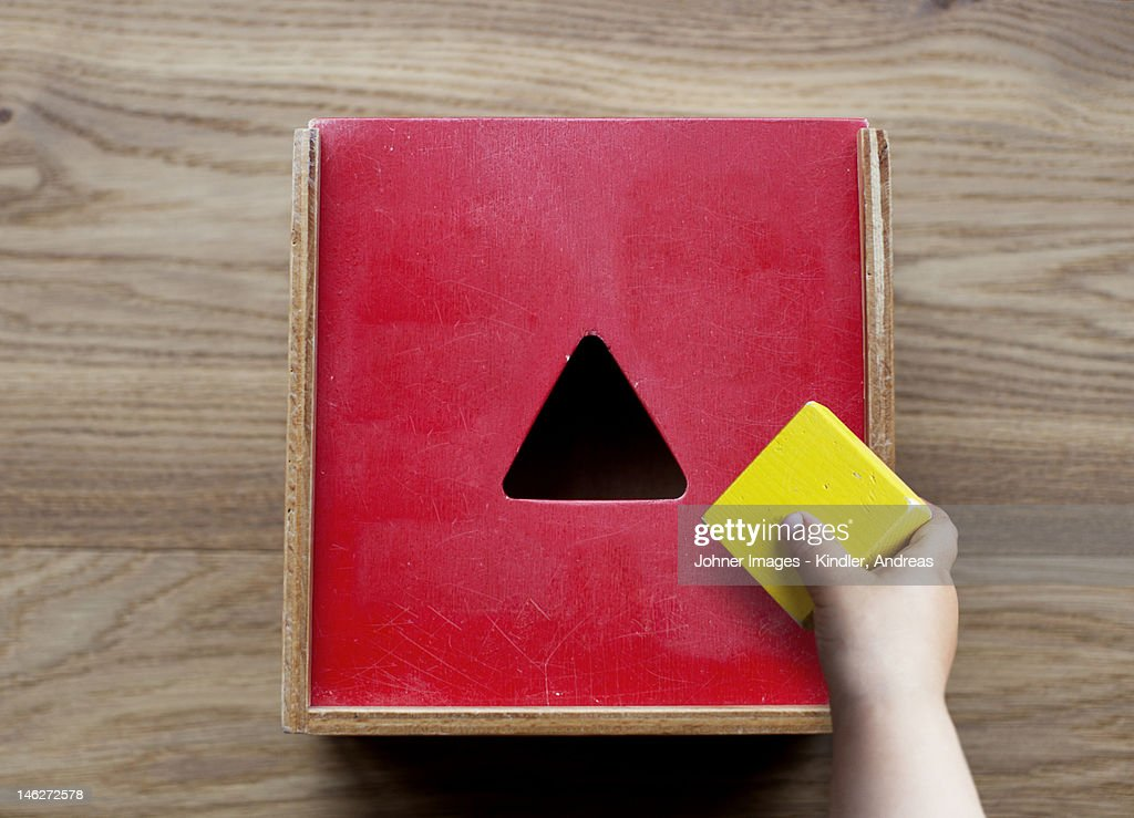 Boy playing with building blocks : Stock Photo