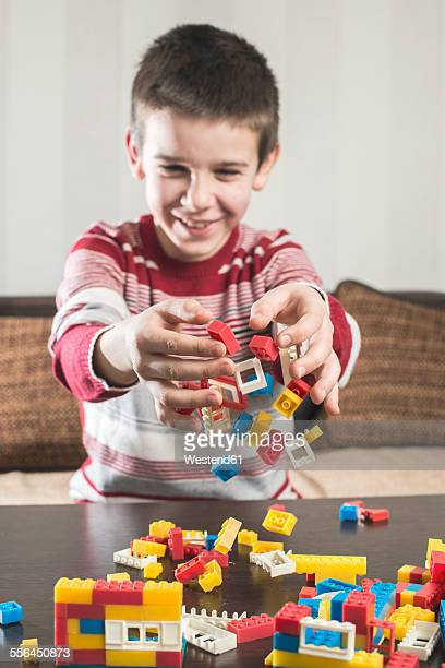 Boy playing with building bricks