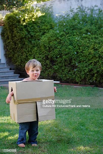Boy playing with cardboard box