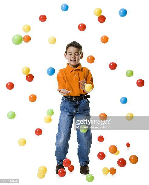 Boy playing with colored balls