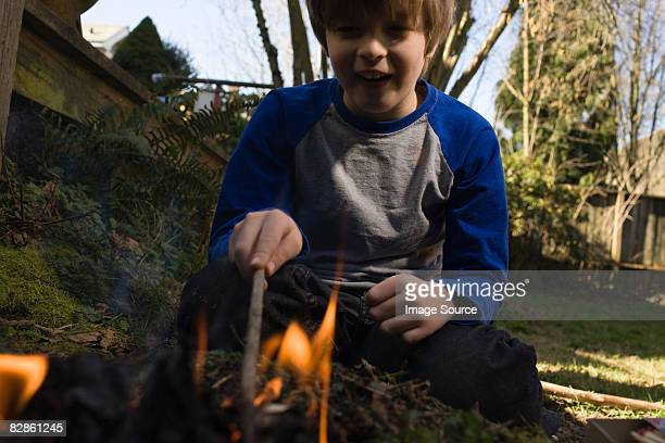 Boy playing with fire