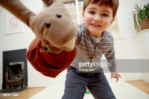 Boy playing with hand puppet
