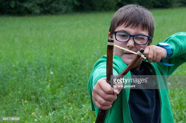 Boy playing with his slingshot