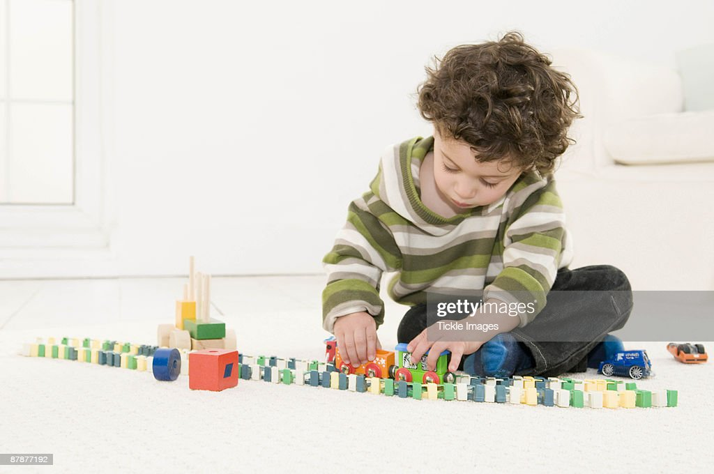 A boy playing with his toys : Stock Photo