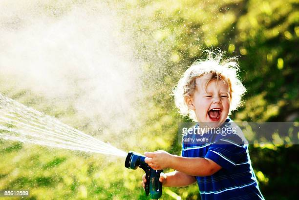 Boy playing with hose