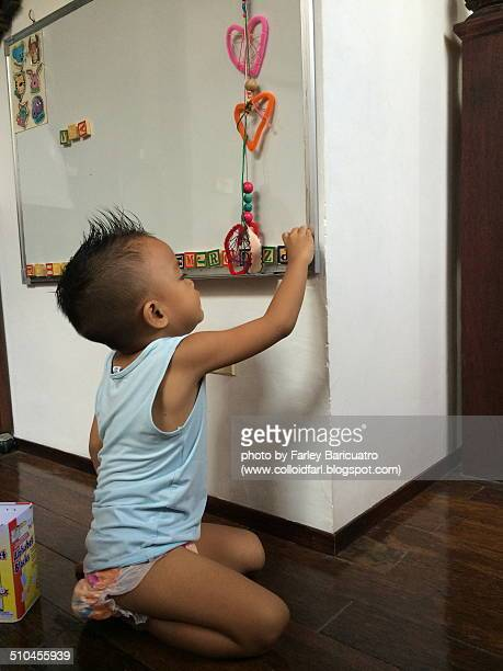 Boy playing with letter magnets