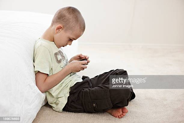 Boy playing with MP3 player