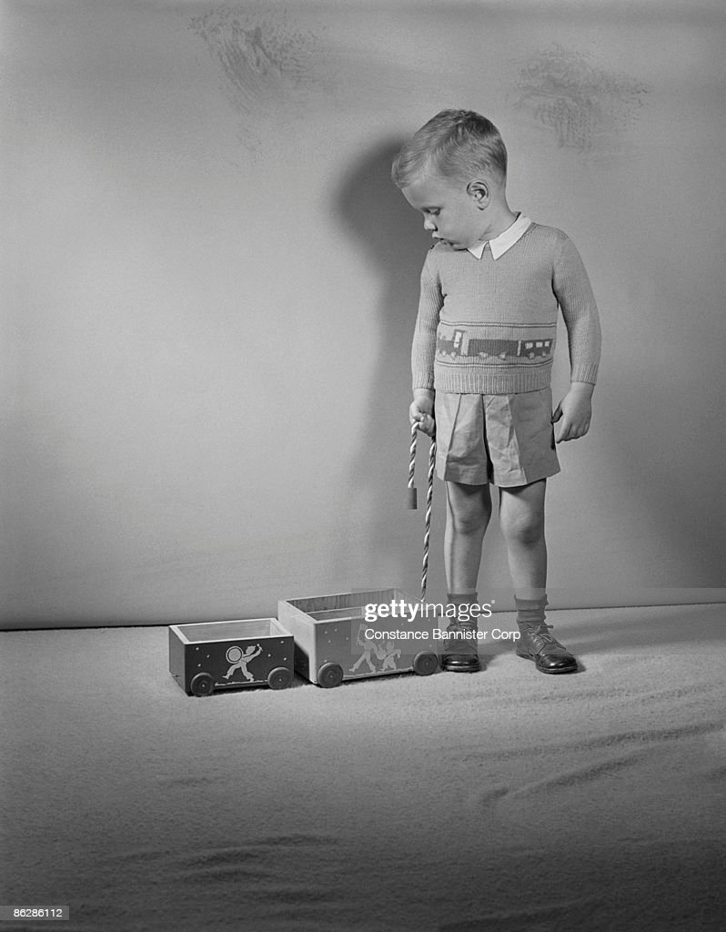 Fashion Toys For Boys : Boy playing with oldfashioned toy stock photo getty images