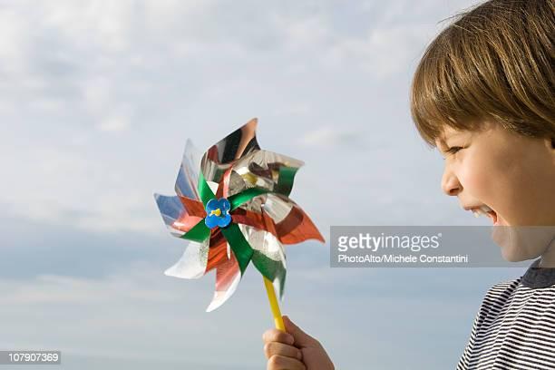 Boy playing with pinwheel