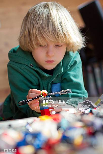 boy playing with lego bricks