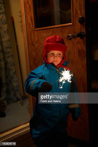 Boy playing with sparkler outdoors