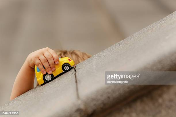 Boy playing with toy car outdoors