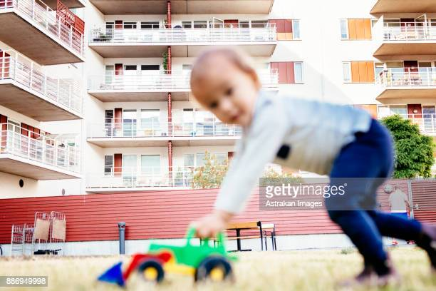 Boy (2-3) playing with toy car