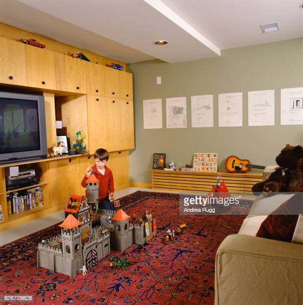 Boy Playing with Toy Castle in Family Room