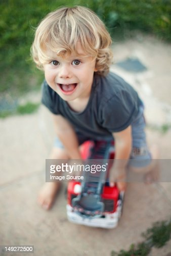 Boy playing with toy fire engine