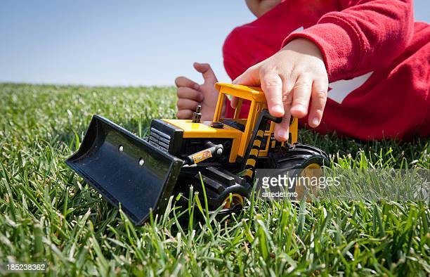 Boy  playing with toy in grass