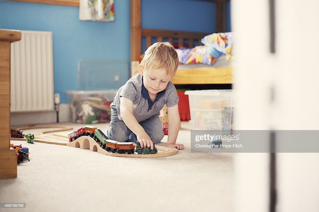 Boy playing with toy trains