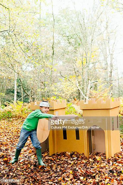 Boy playing with toys in forest