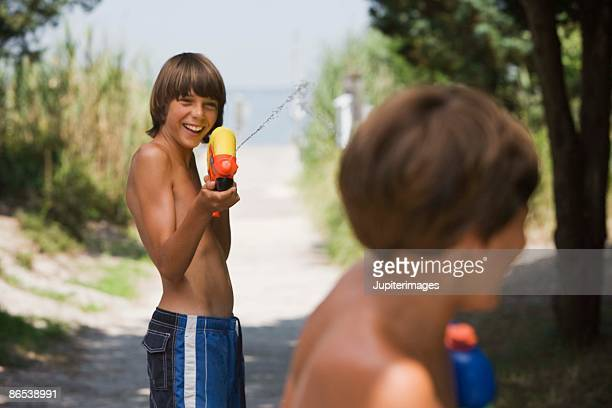 Boy playing with water gun