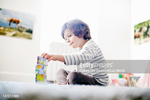 Boy playing with wooden blocks : Stock Photo