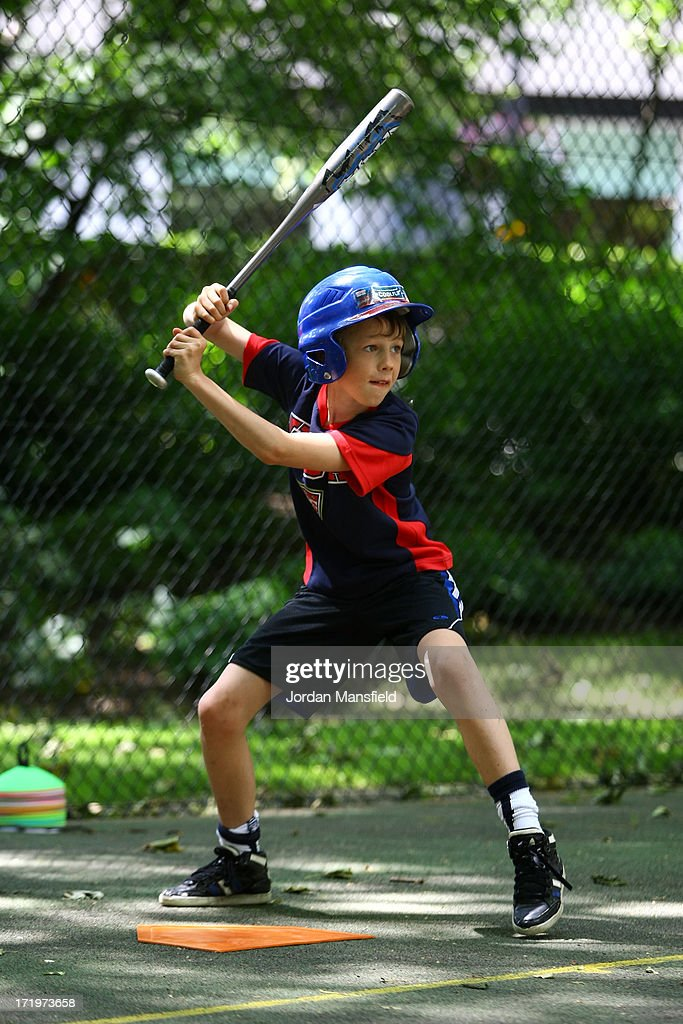 A boy plays baseball on June 30, 2013 in London, England. American Democrats living in London gather in Portman Square for the largest Independence Day celebration in London ahead of the American federal holiday on the 4th July which commemorates the Declaration of Independence on July 4, 1776 which declared them the USA free from the Kingdom of Great Britain.