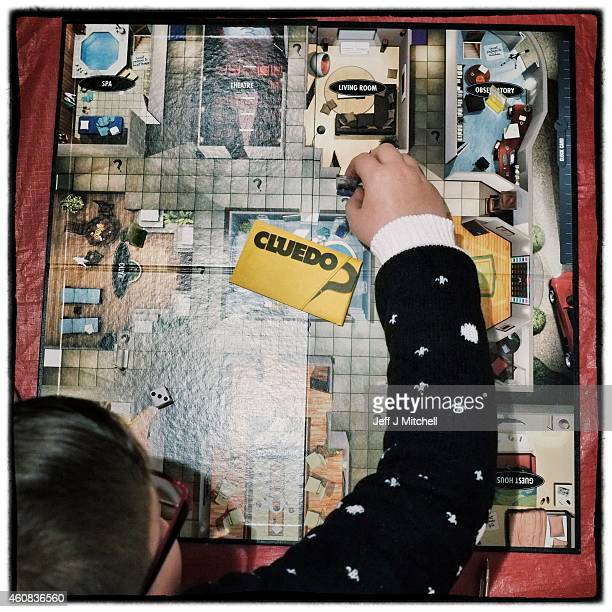 A boy plays cluedo following Christmas dinner on December 25 2014 in Glasgow Scotland Millions of people across the UK spend time with family and...