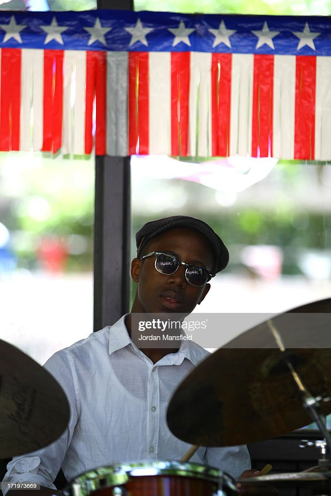 A boy plays drums on June 30, 2013 in London, England. American Democrats living in London gather in Portman Square for the largest Independence Day celebration in London ahead of the American federal holiday on the 4th July which commemorates the Declaration of Independence on July 4, 1776 which declared them the USA free from the Kingdom of Great Britain.