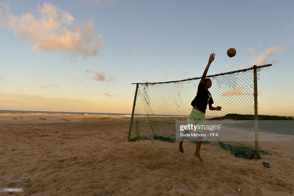 Boy plays football in Mucuripe beach on June 18, 2013 in Fortaleza, Brazil.