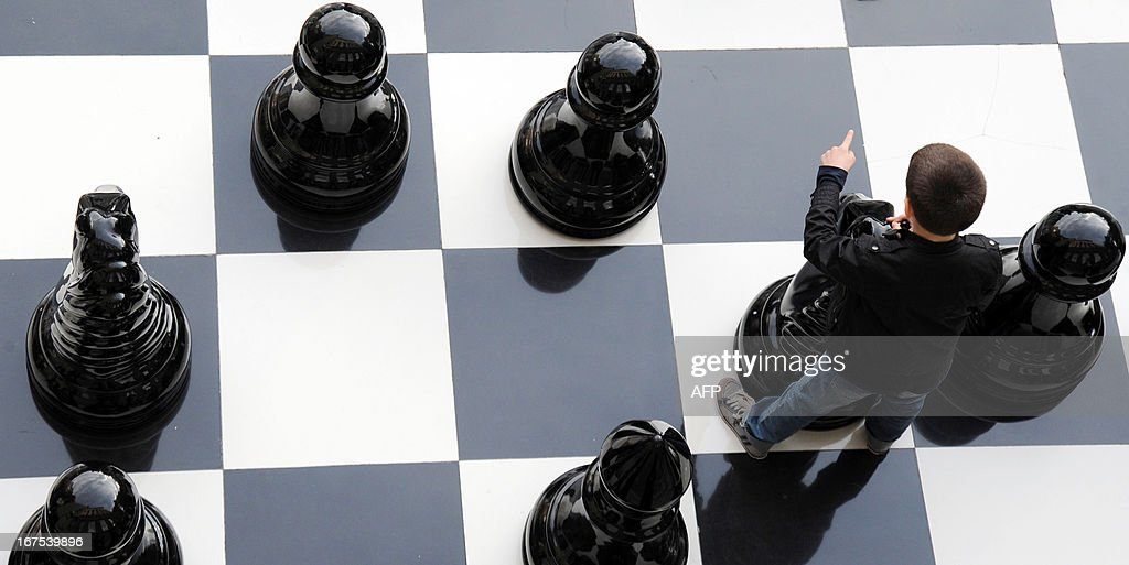 A boy plays giant chess in central Yerevan on April 26, 2013.