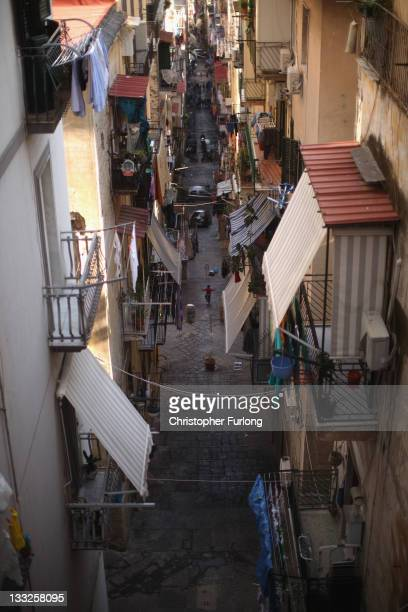 A boy plays in an alleyway of densely populated Naples on November 18 2011 in Naples Italy Italy's new Prime Minister Mario Monti and his new cabinet...