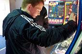 A boy plays in an amusement arcade at Alton Towers Alton England UK