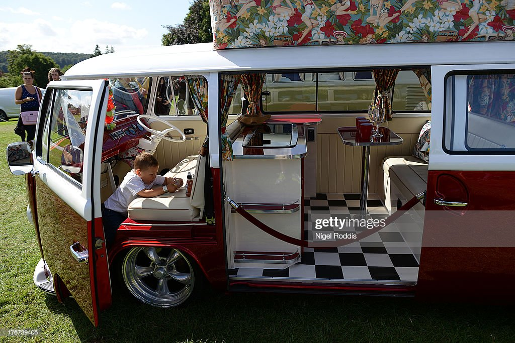 A boy plays in his VW campervan during the In Praise Of All Things VW At The Annual Festiva at Harewood Housel on August 18, 2013 in Leeds, Yorkshire. The annual VW festival in its 9th year attracts around 15,000 people over the weekend, ending with the winners car parade on Sunday.