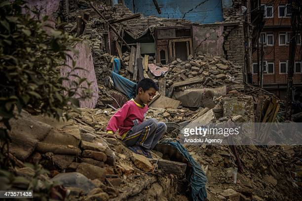 A boy plays on the collapsed house in Sankhu village in Kathmandu Nepal on May 16 2015 following the second major earthquake The second major...