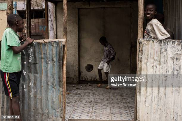 A boy plays soccer in the Mathare North neighborhood on August 14 2017 in Nairobi Kenya Nairobi remained peaceful but tensions remain high as...