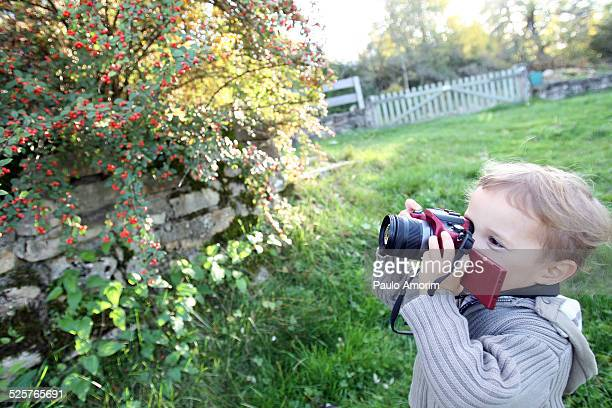 A boy plays the photographer in Autumn