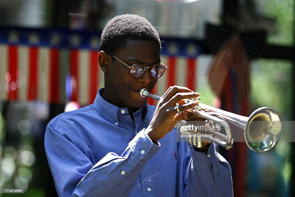 A boy plays the trumpet on June 30, 2013 in London, England. American Democrats living in London gather in Portman Square for the largest Independence Day celebration in London ahead of the American federal holiday on the 4th July which commemorates the Declaration of Independence on July 4, 1776 which declared them the USA free from the Kingdom of Great Britain.