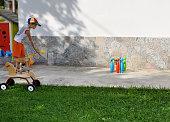 Boy plays toy bowling