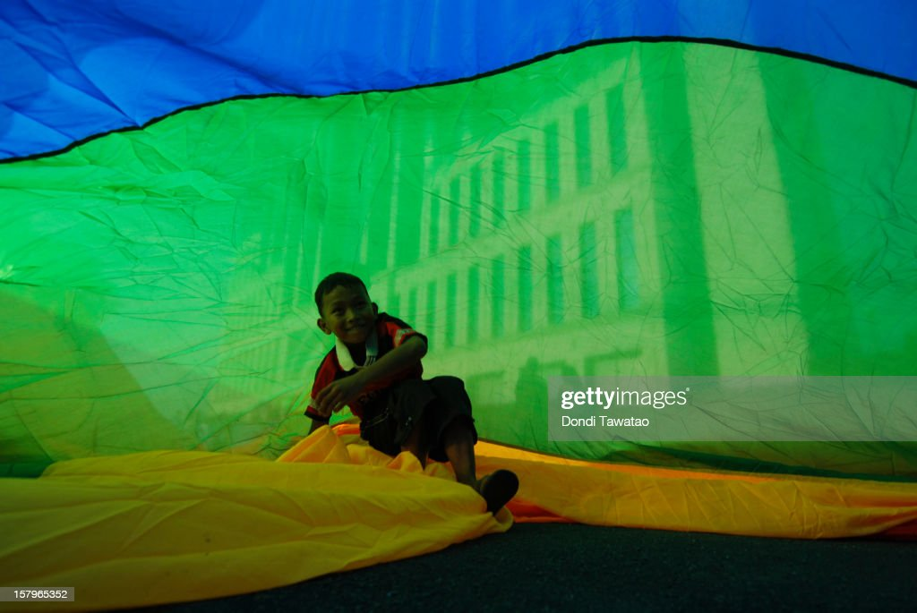 A boy plays under a rainbow flag during the Manila Gay Pride March on December 8, 2012 in Makati, Philippines. Although frowned upon by the mainstream Catholic church, Filipino LGBTs are slowly gaining ground as a vibrant and vocal movement as they prepare to field their very own political party in next year's midterm elections for the first time. The Ang Ladlad party (Coming Out party) is set to become Asia's very first lesbian gay bisexual transexual political party.