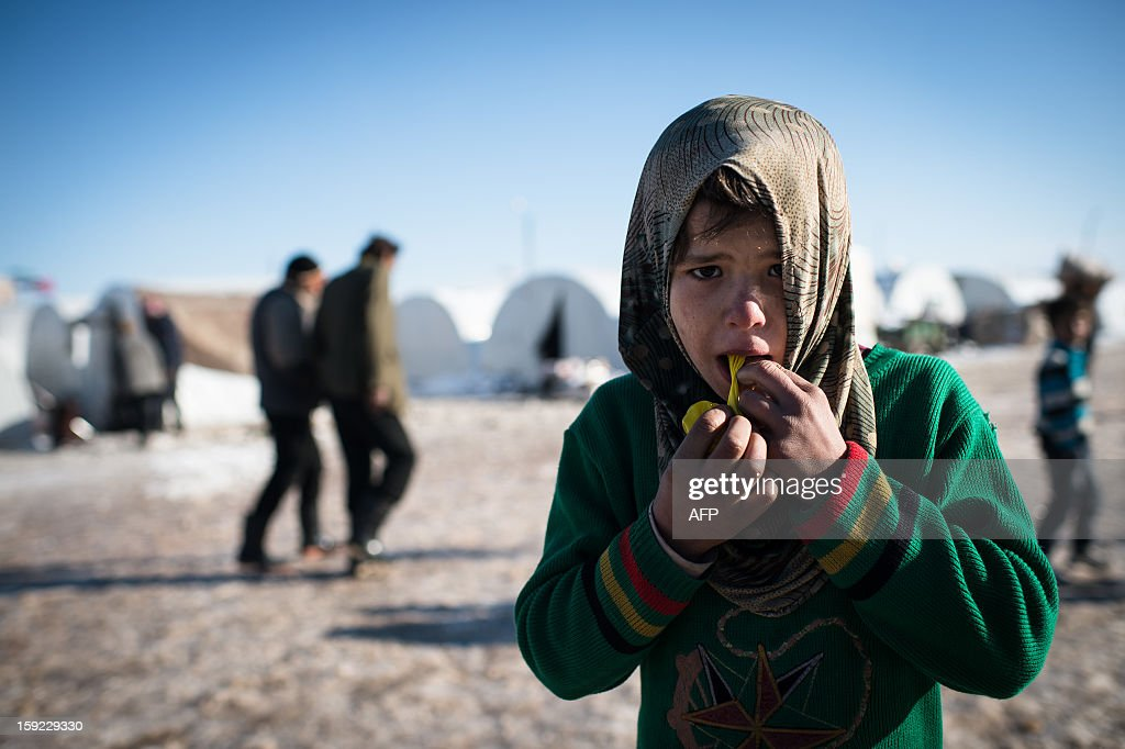A boy plays with a balloon in a Syrian refugees camp in Azaz near the Turkish border on January 10 2013 after snow falls Snow carpeted Syria's...