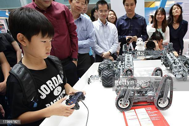 A boy plays with a lego replica of a QuadTracked Robotic Platorm during Xperiment a weekend science carnival to kick off the Singapore Science...