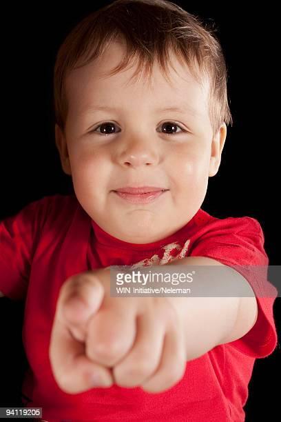 Boy pointing forward