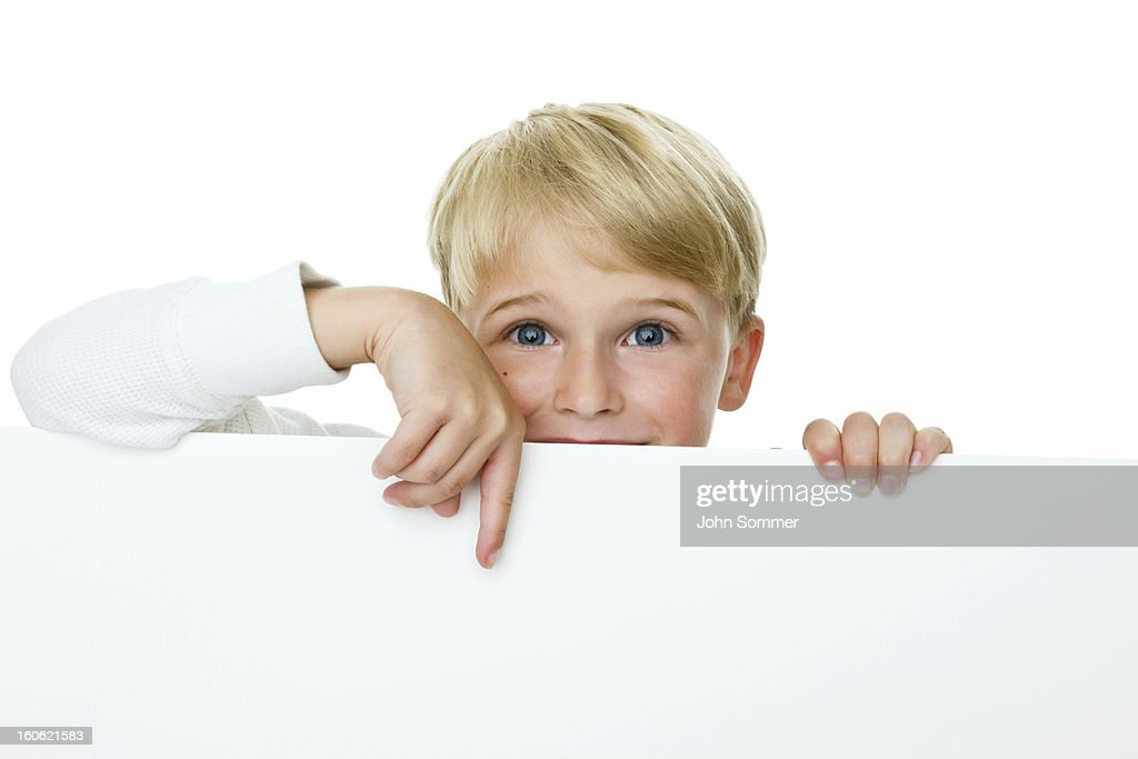 Boy pointing to copy space : Stock Photo