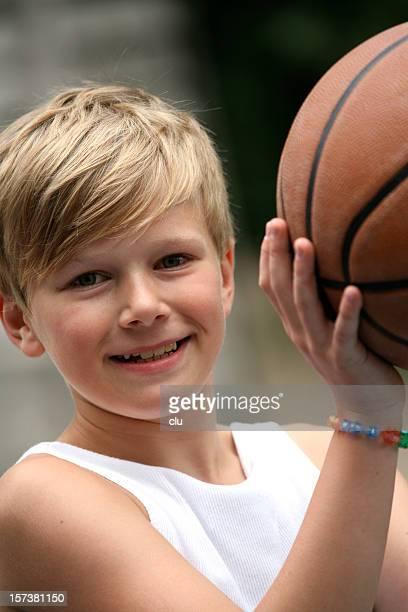 Boy portrait with basketball