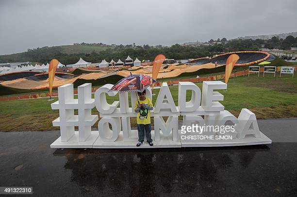 A boy poses at the at the Cidade Olimpica of Deodoro in Rio de Janeiro Brazil on October 4 2015 as a BMX test event for the 2016 Rio Olympics Games...