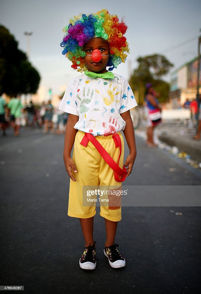 A boy poses outside of the Sambodromo during Carnival celebrations on March 3, 2014 in Rio de Janeiro, Brazil. Carnival is the grandest holiday in Brazil, annually drawing millions in raucous celebrations.