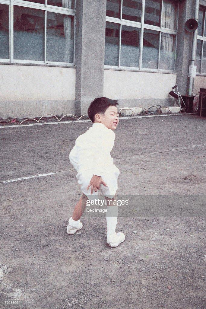 Boy posing in school yard : Stock Photo