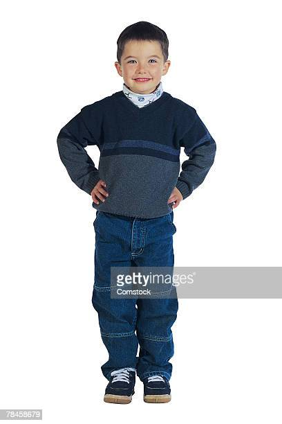 Boy posing with hands on hips