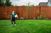 Boy Posing with Soccer Ball