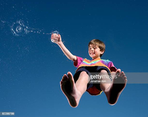 Boy pours a glass of water.